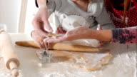 Housewife with her daughter preparing gingerbread video