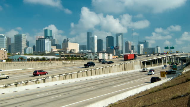Houston TX Freeway Interstate Traffic with Downtown Backdrop video
