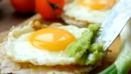Huevos rancheros tostadas with avocado salsa video
