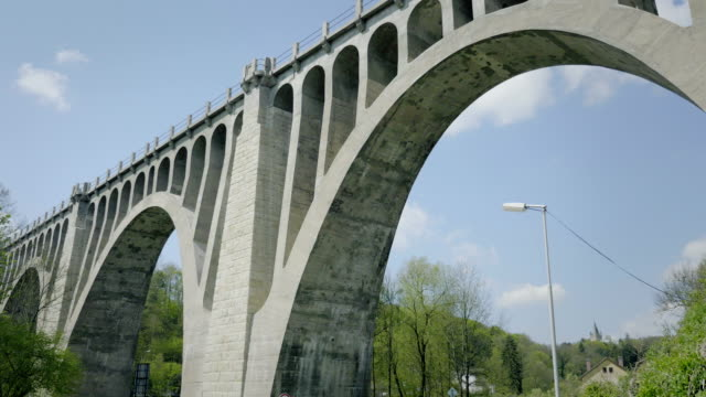 Huge concrete bridge with arched arches. Overlooking construction of valley bridges. video