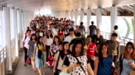 Huge crowds of people walk on the way to Sky train video