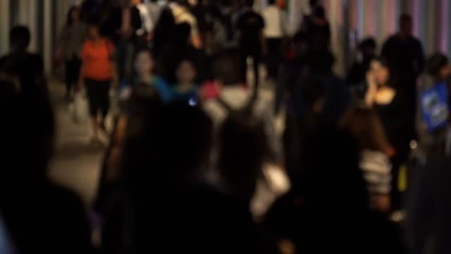 huge crowds of people walk on the way video