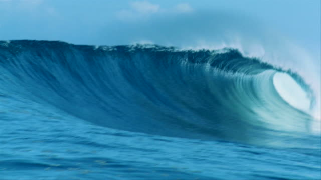 Huge heavy wave barreling across a reef in Indonesia video