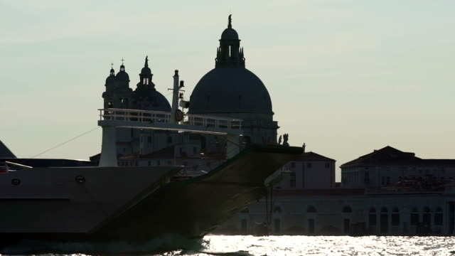 Huge passenger cruise ship passing ancient church, Venice cityscape at dusk video