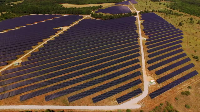 AERIAL: Huge power plant using renewable solar energy with sun video
