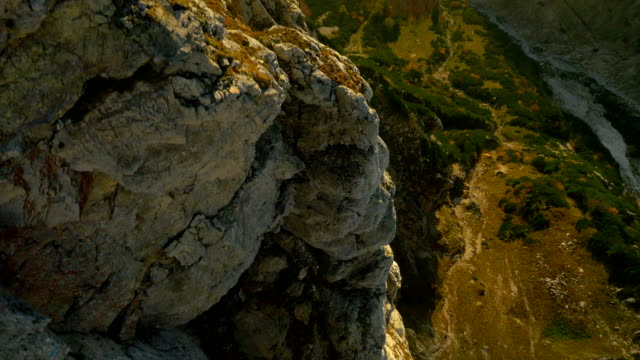 AERIAL: Huge rocky wall in the mountains video