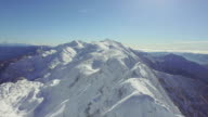 AERIAL: Huge snowy mountains in winter video