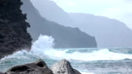 SLOW MOTION: Huge wave splashing into enormous ocean cliff rising out of the sea video