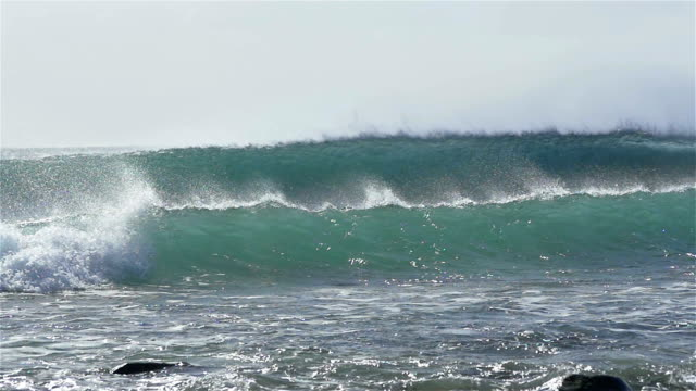 SLOW MOTION: Huge waves breaking and splashing towards the beach video