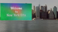 Huge Welcome to New York City sign dragging after boat video