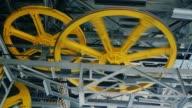 Huge wheels hoist elevators or funicular video