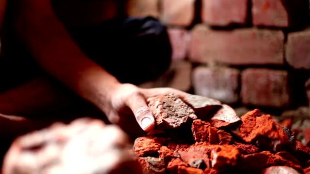 Human hand breaking brick using hammer video