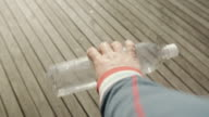 Human hand pick up plastic bottle Point of view video