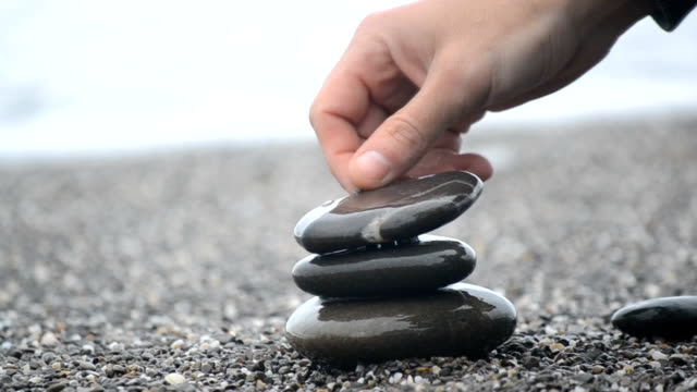 human hand put last stone video