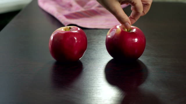 Human hand putting fresh apples on table. Organic apple fresh healthy fruit video
