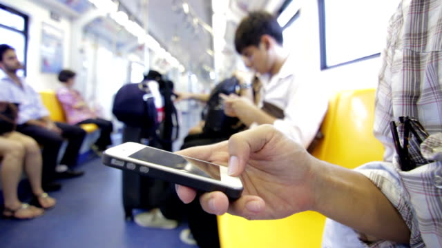 Human Hand Using Smartphone on The Train,Close-up video
