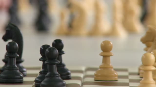 HD: Human Hands Moving Chess Figurines video