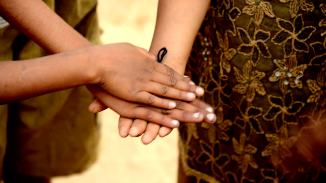 Human hands showing unity video