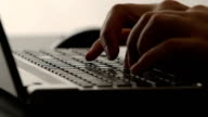 CLOSE UP: A human hands typing on a notebook video