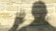 human shadow on a wall counting to five video