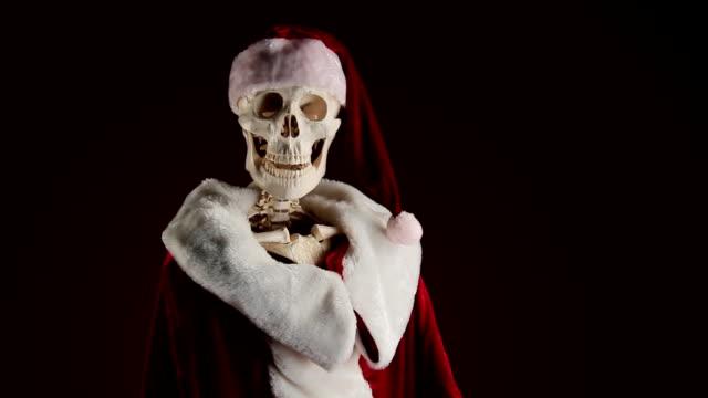 Human skeletal Santa Claus waving video