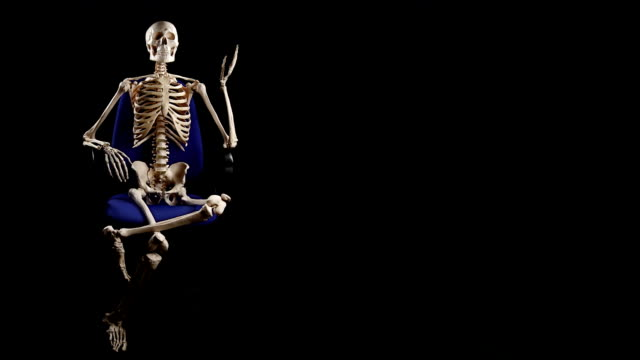Human skeleton sitting at chair and talking video