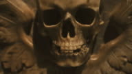 Human skull marble sculpture in a church of Rome video