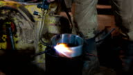 Human warms up the mold of metal by burner video