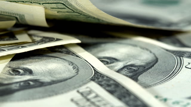 Hundred dollar bills on the table video