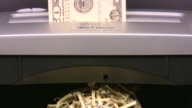 $100 hundred dollars bills into paper shredder. Currency. Finance. Money. video