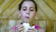 Hungry girl eats white bread video