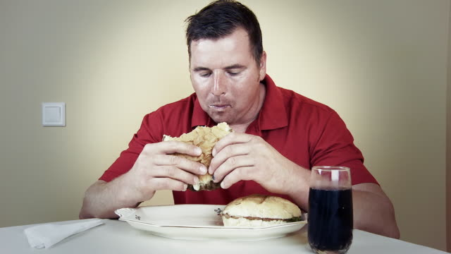 HD TIME LAPSE: Hungry Man Eating Hamburgers video