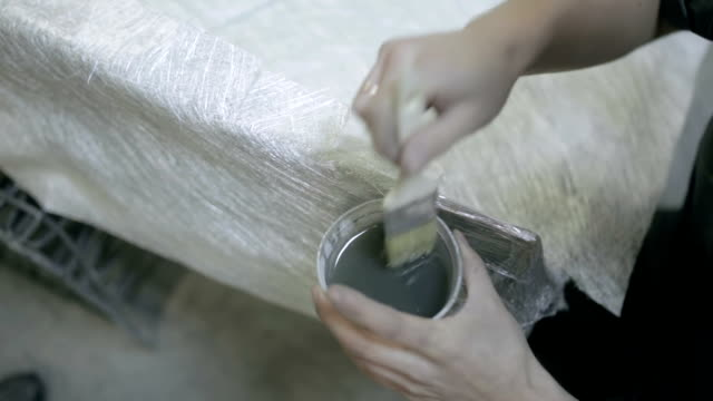 Hunky apply varnish on the surface of the item video