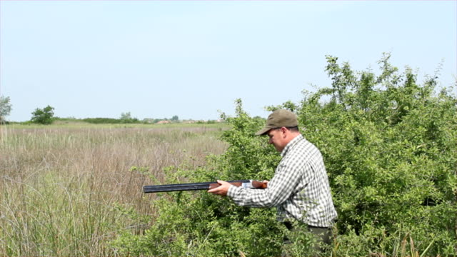 hunter loading shotgun and shooting video