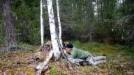 Hunter man shoots from a gun video