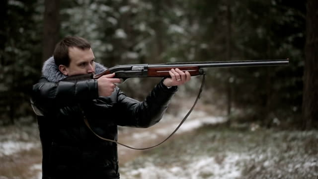 Hunter shoots a gun second man forbids him to shoot video