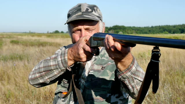 Hunter with a gun video