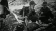 1939: Hunting couple pose with field dressed gutted whitetail deer. video