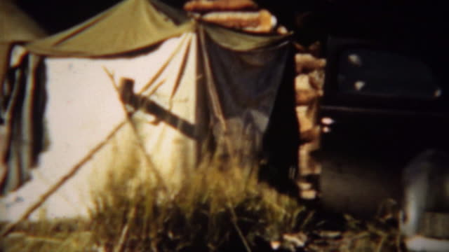 1939: Hunting trip car and canvas style camping tents. video