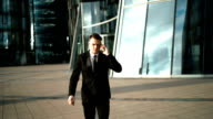 Hurry businessman with smartphone video