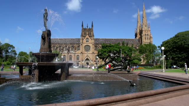 Hyde park fountain with St Mary Cathedral on the background in sydney video