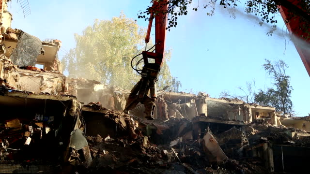 Hydraulic crusher excavator machinery working on demolition old house video