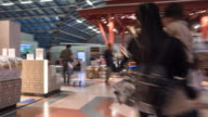 Hyper lapse - Crowded people shopping in duty free at airport video