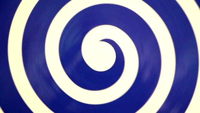 Hypnotic rotating blue spiral on white video