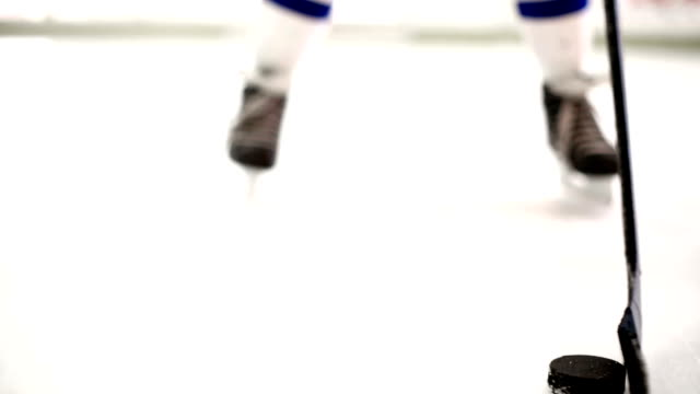 Ice hockey player playing a puck. video