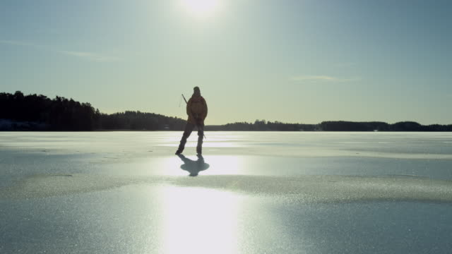 Ice skater in backlight video