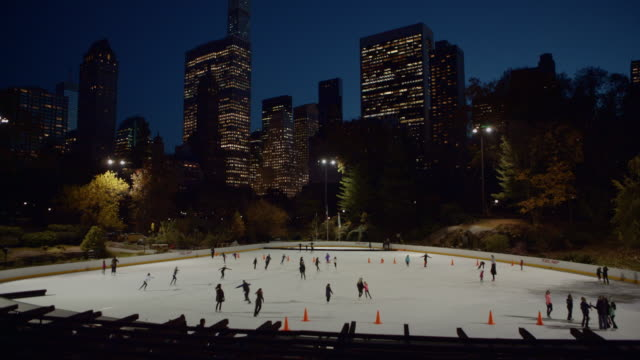 Ice skating in Central Park at dusk New York City video