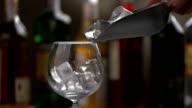 Ice slowly falls into wineglass. video