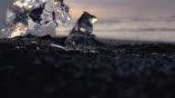 SLO MO CU Iceberg melting on black beach video