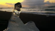 SLO MO DS Iceberg on the beach at sunset video